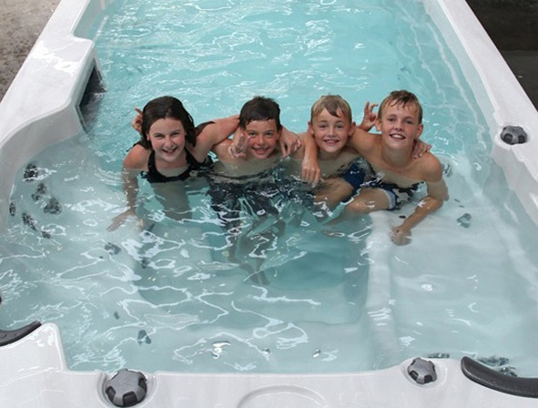 kids in swim spa